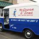 White and blue van that says McGowan & Sons