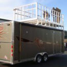 Brown enclosed trailer with red stripes